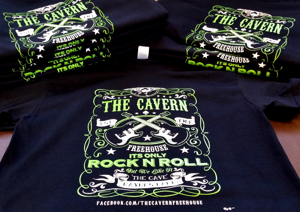 An image of printed black t-shirts for The Cavern